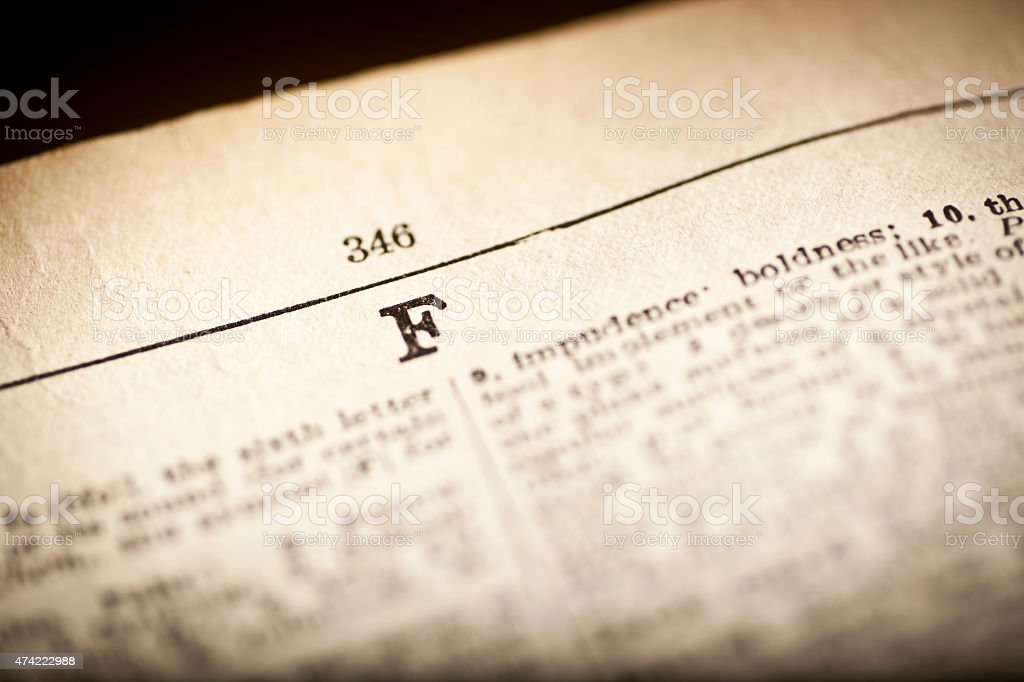 Old dictionary open at letter F stock photo