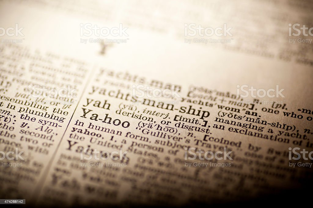 Old dictionary open on the word yahoo stock photo