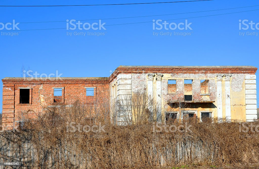 old dilapidated building with brick walls and ancient columns stock photo