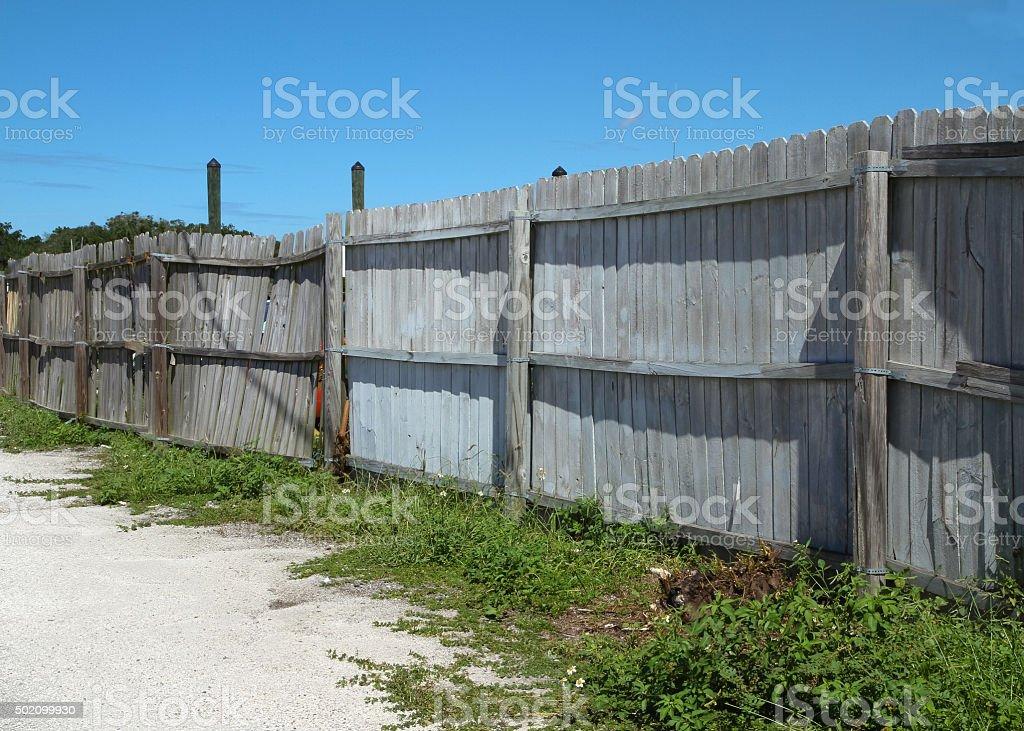 Old dilapidated stockade fence stock photo