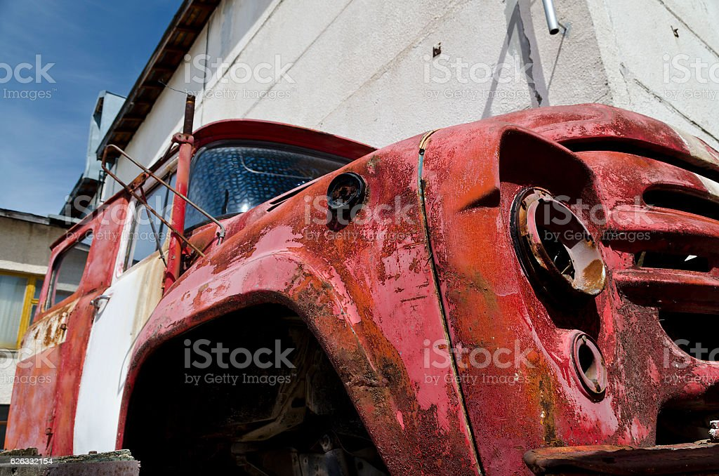 Old dilapidated truck in the back yard stock photo