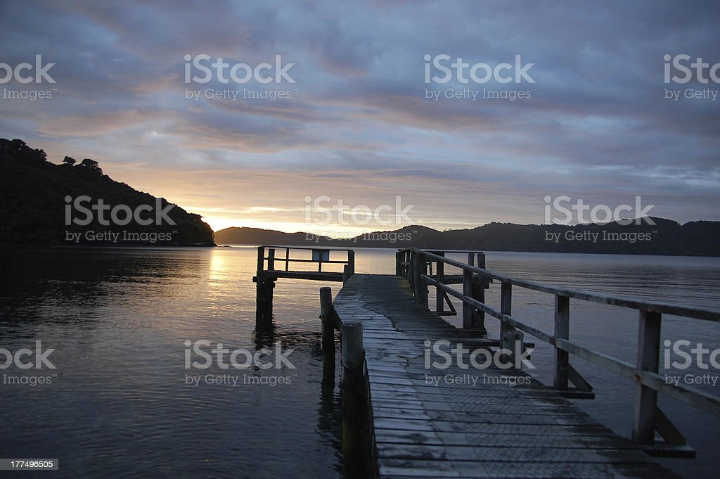 Old dilapidated wharf at dawn Stewart Island royalty-free stock photo