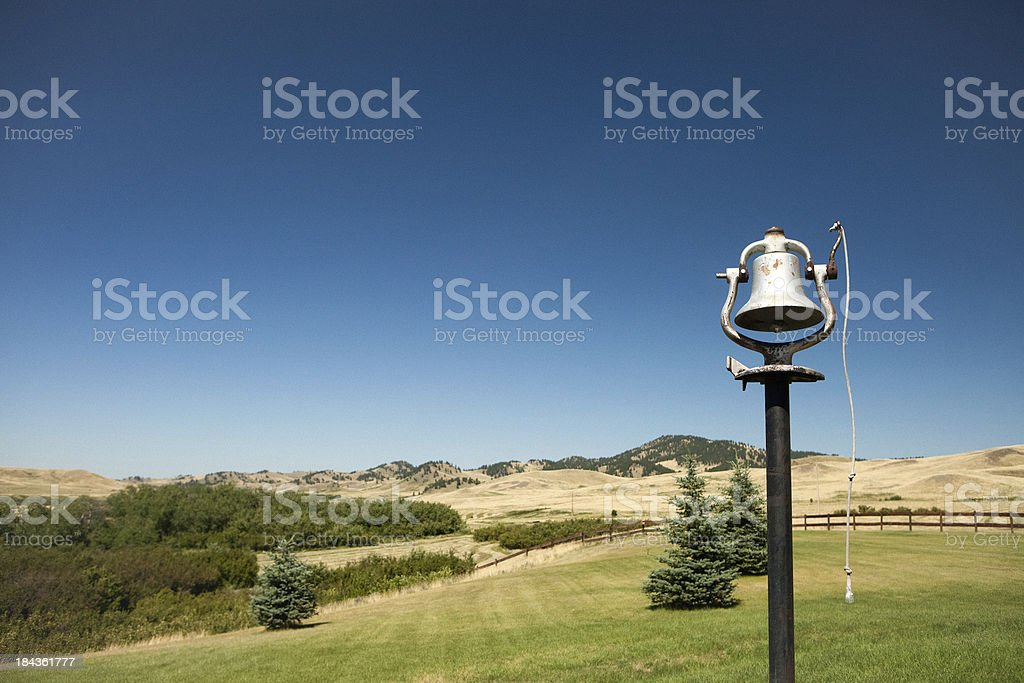 Old Dinner Bell And Country Scenery stock photo