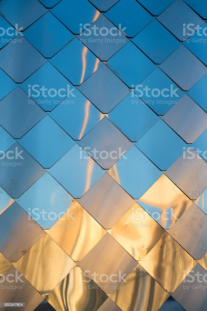 old, dirty aluminum metal wall facade panel with rhombus, similar stock photo