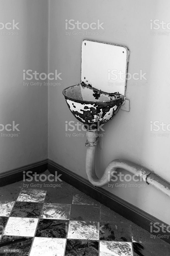 Old Dirty Bathroom with Rusted Sink stock photo