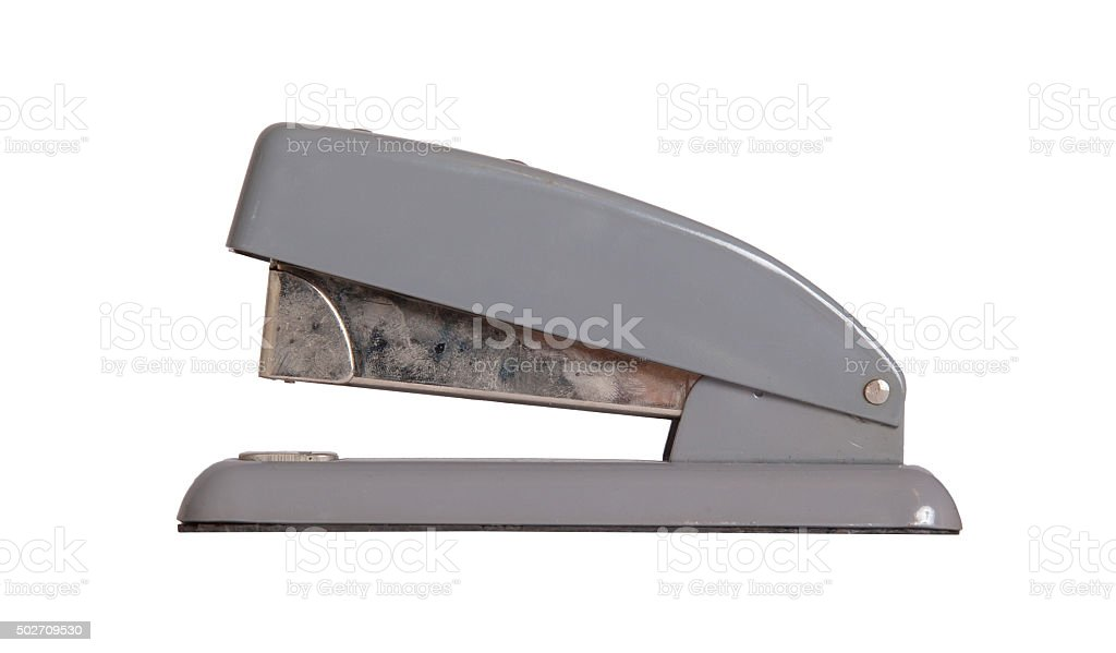 Old dirty stapler isolated stock photo