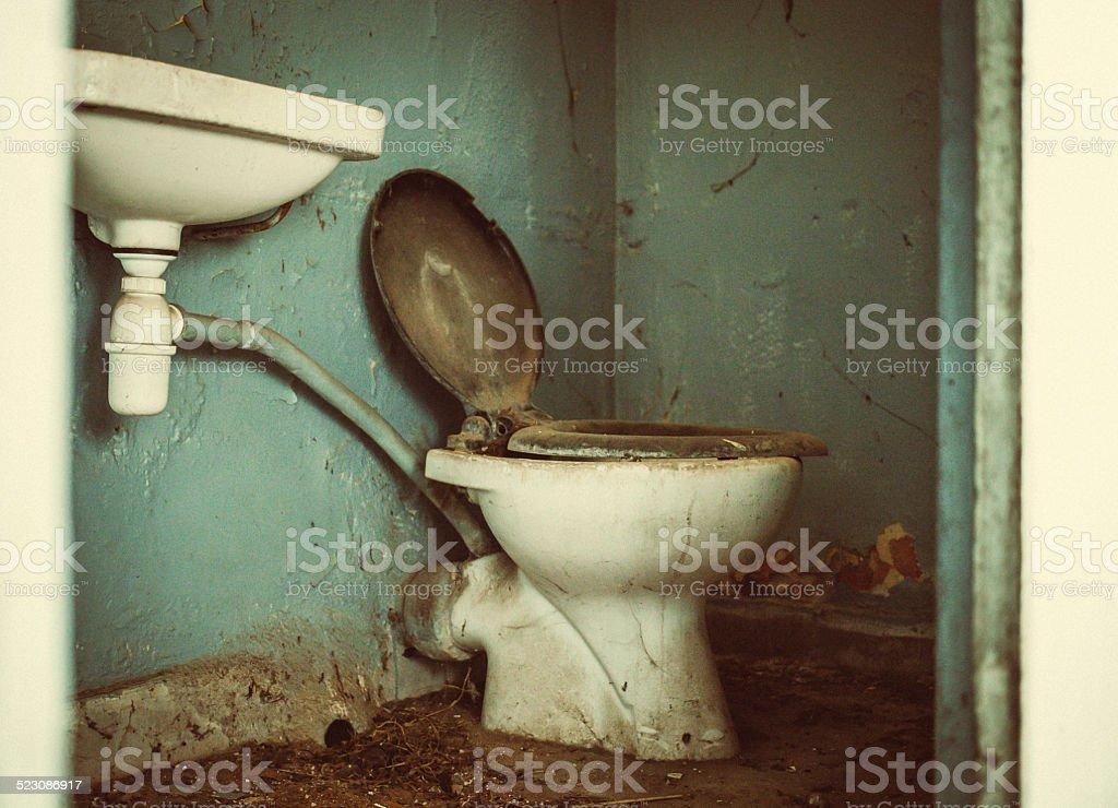 Old dirty toilet stock photo