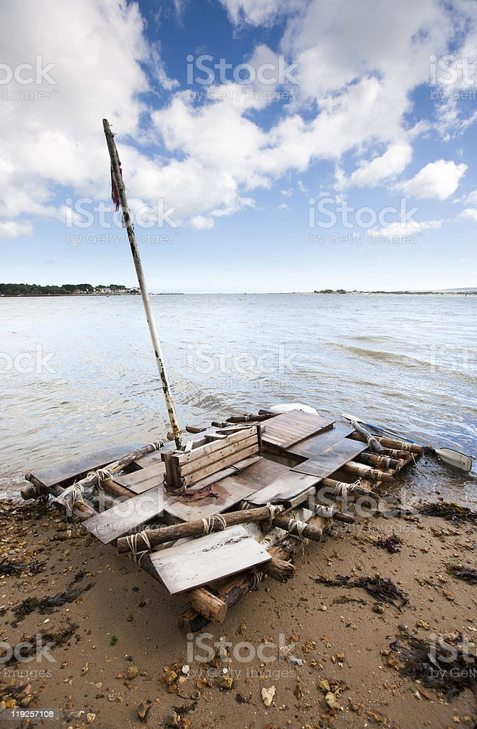 Old discarded wooden raft stock photo