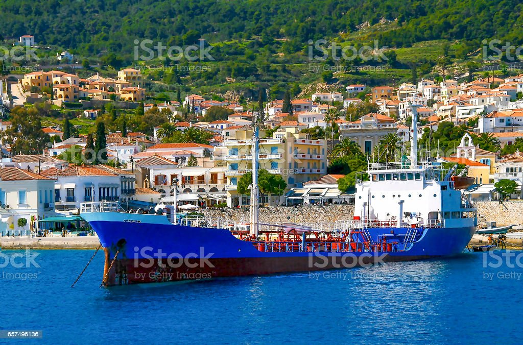 Old docked ship transfer water in Spetses island,Greece stock photo