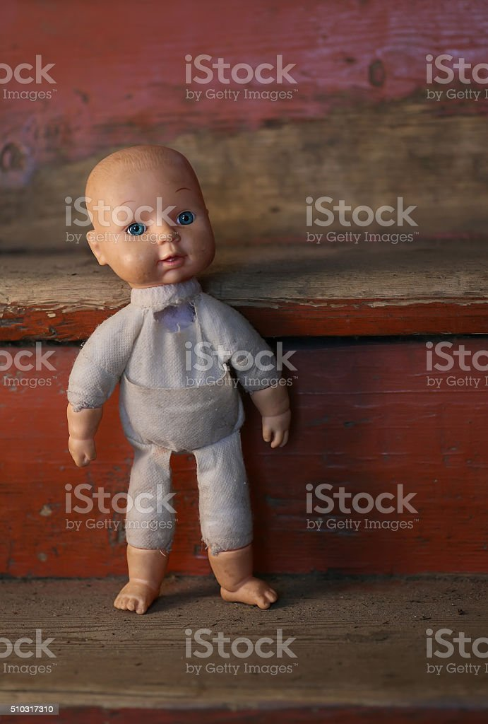 Old Doll. Concept: Abandoned Person. Close up an old broken stock photo