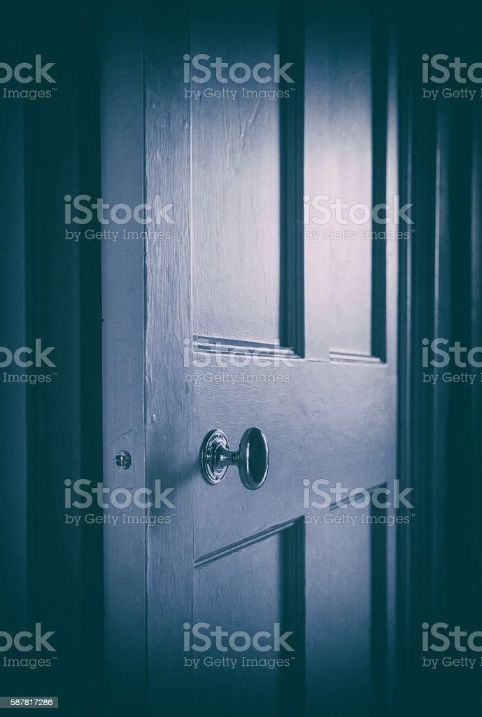 Old Door Ajar in the Dark stock photo