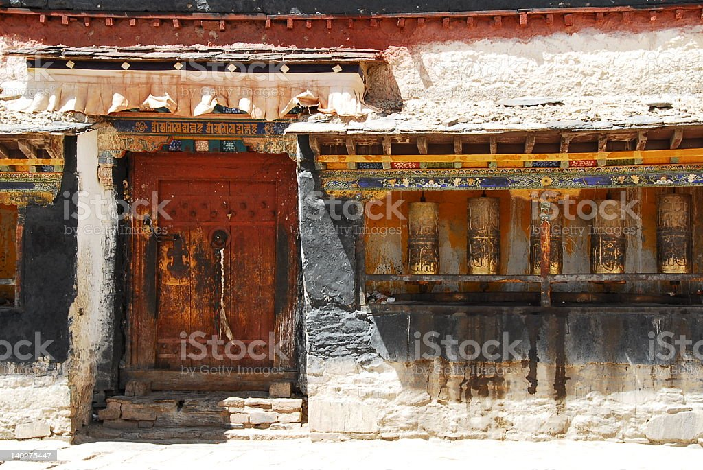 Old door and prayer wheels royalty-free stock photo