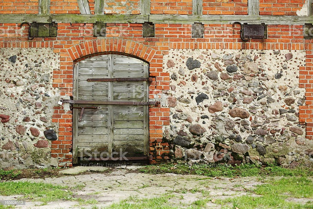 old door and wall with stones royalty-free stock photo