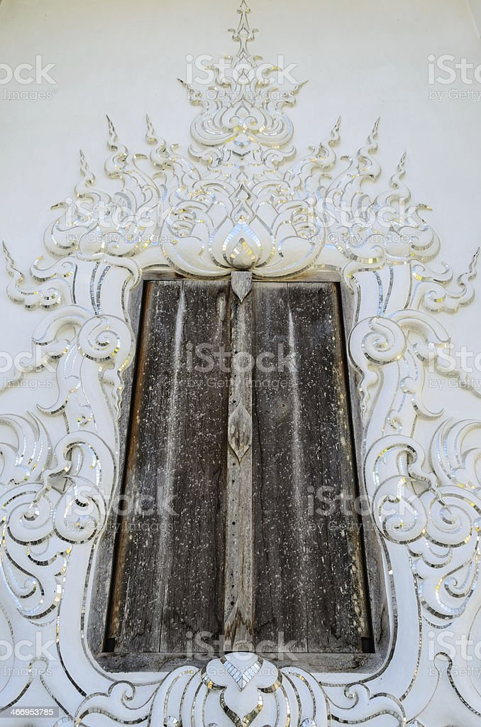 Old Door at Wat Rong Khun, Chiang Rai Province, Thailand stock photo