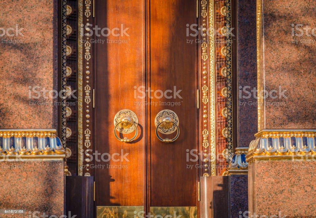 Old Door Fragment of Buddhist temple 'Datsan Gunzechoyney' St. Petersburg, Russia. Buddhist datsan stock photo