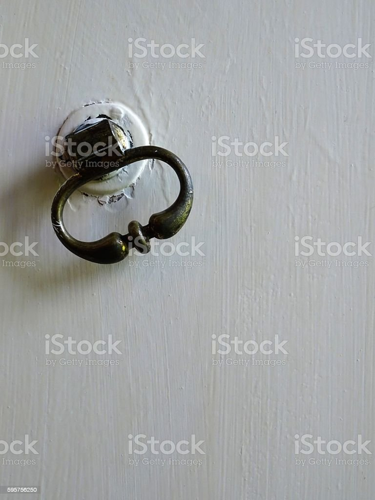 Old door handle of a medieval house stock photo