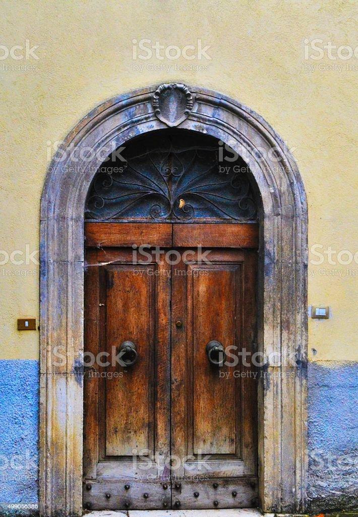 Old door in old building stock photo