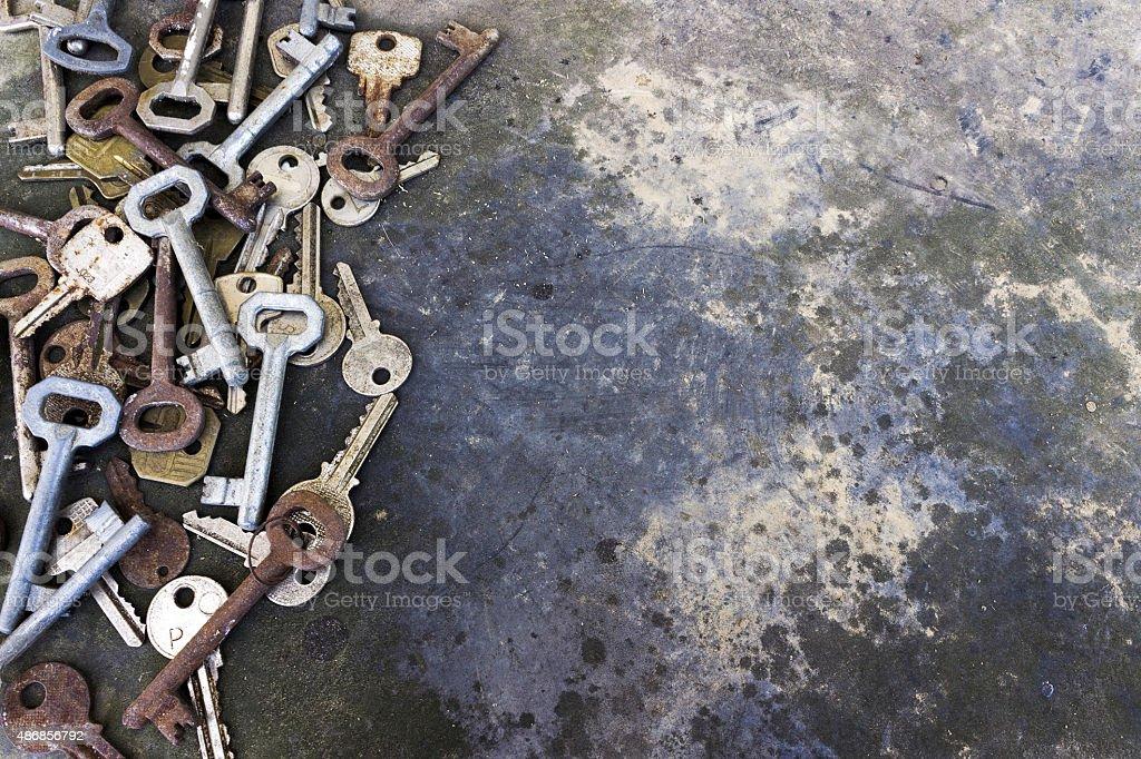 Old door keys rustic background stock photo