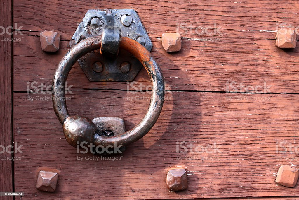 Old door knocker on a wooden gate stock photo