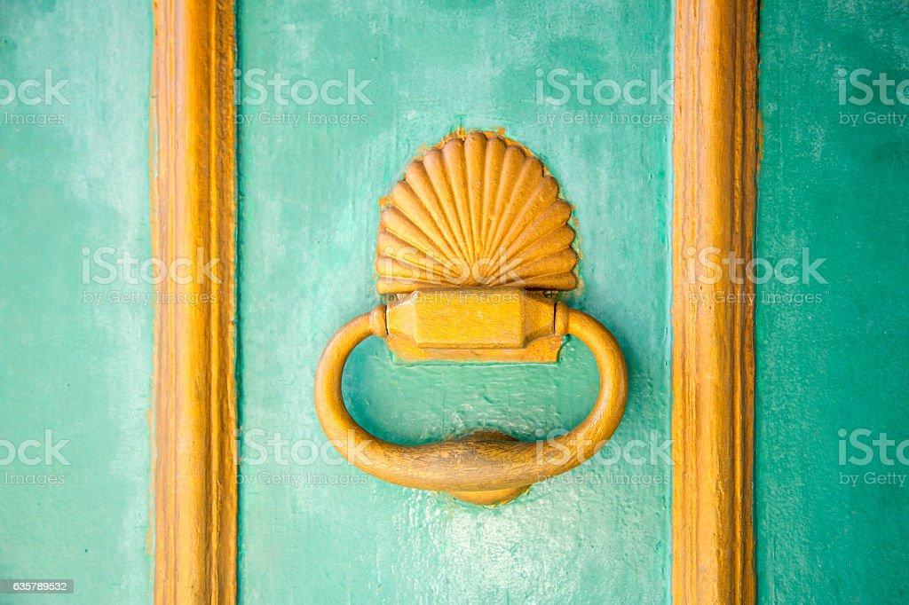 Old door knocker on wooden door stock photo