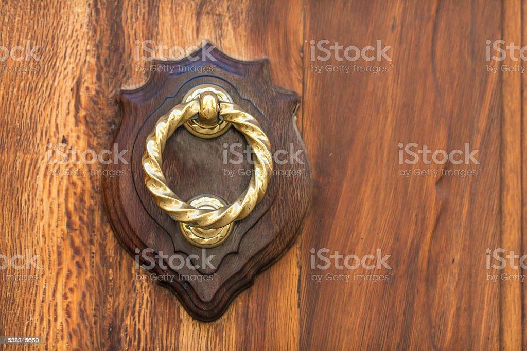 old door knocker with golden ring - doorknob stock photo