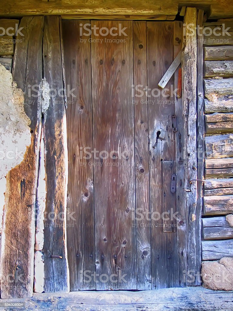 Old door made of planks stock photo
