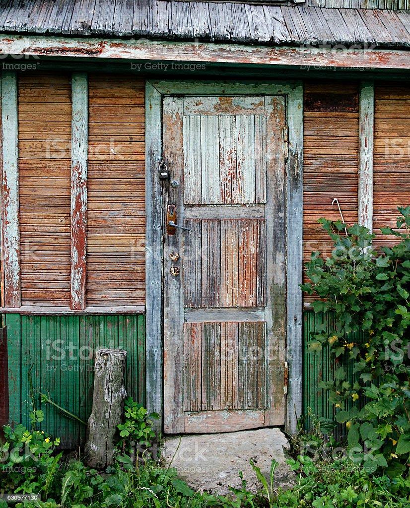 Old door of ramshackle house. stock photo