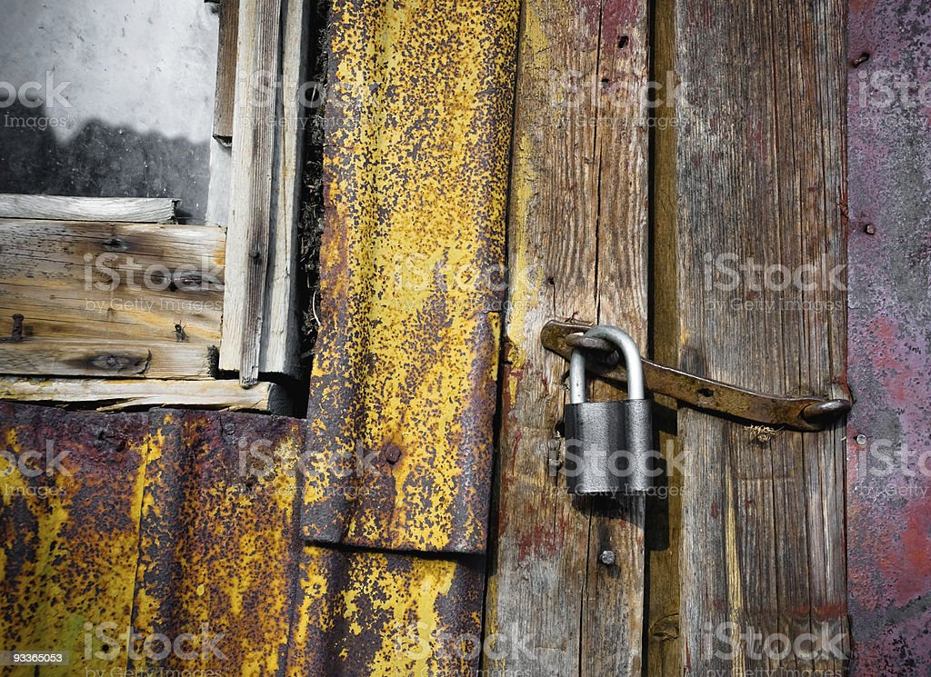 Old door with padlock royalty-free stock photo