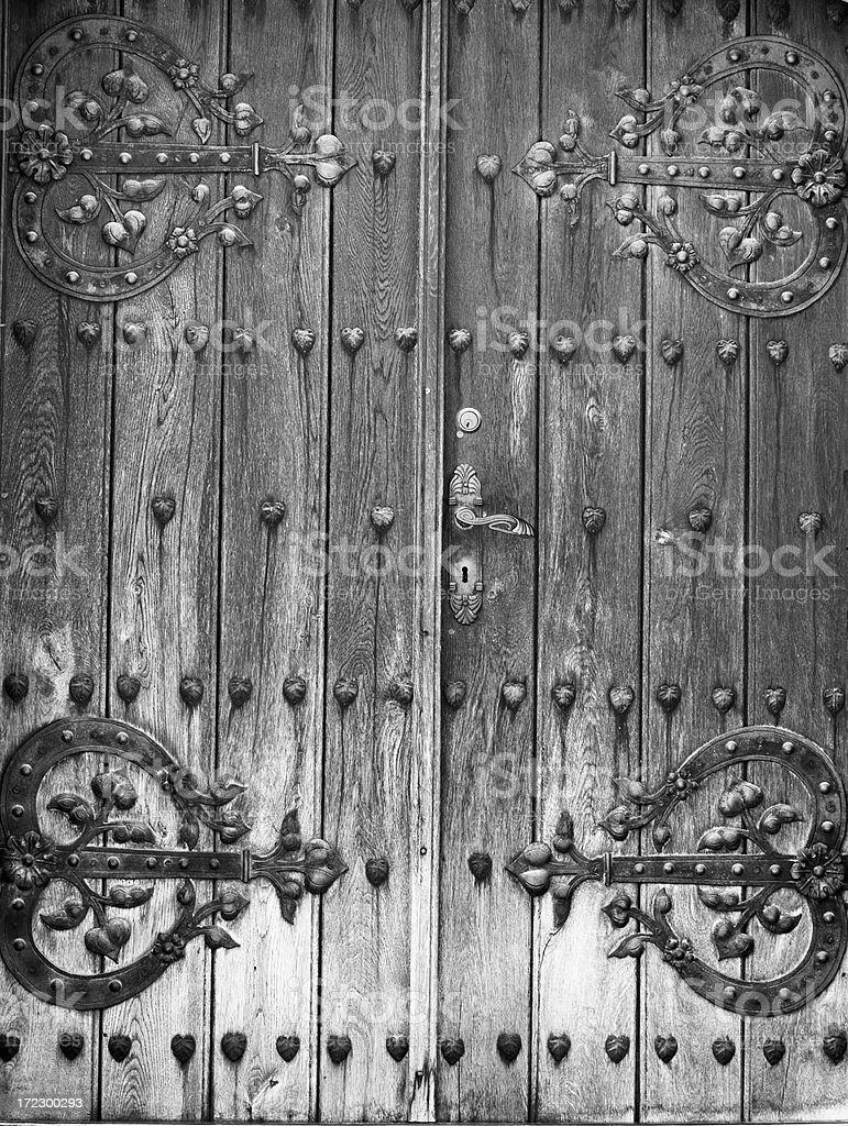 Old door with rusty iron stripes royalty-free stock photo