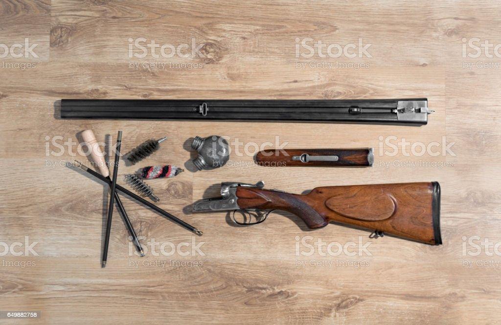 old double-barreled shotgun, disassembled, gun cleaning set, oiler, ramrod stock photo