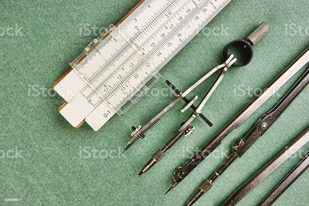 Old drawing tools on a green background royalty-free stock photo