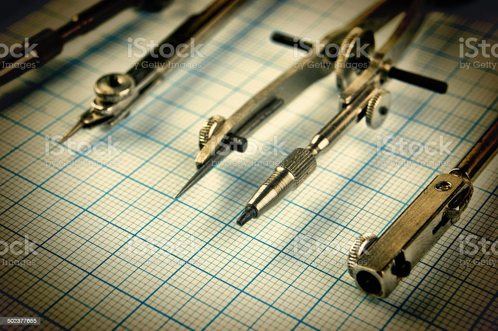 Old drawing tools on graph paper royalty-free stock photo