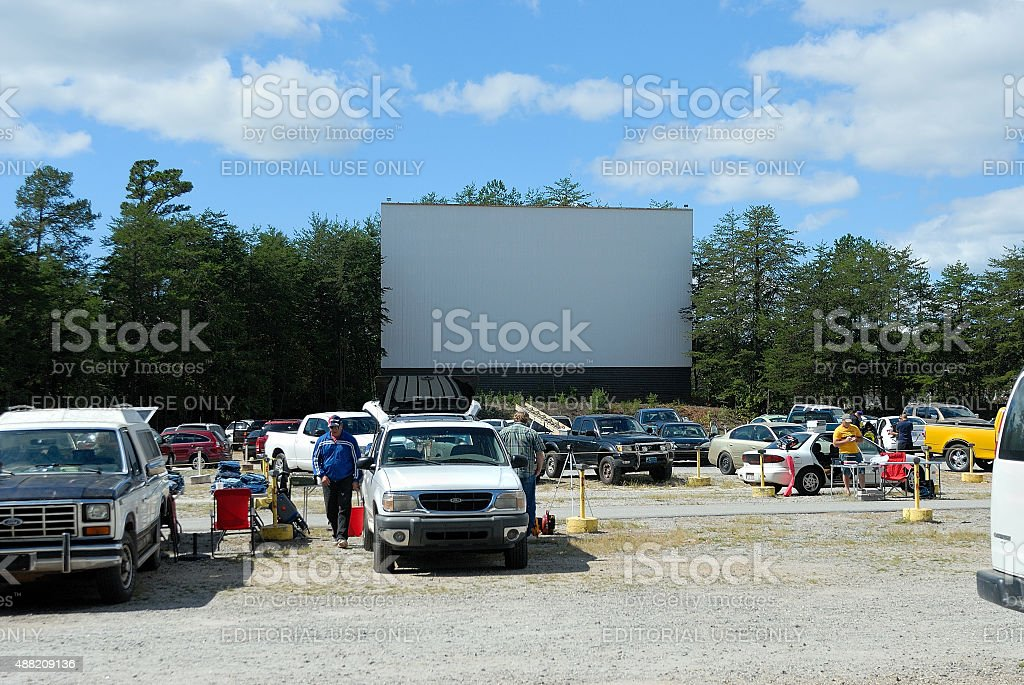 Old drive-in screen and speaker posts remain at farmers market stock photo