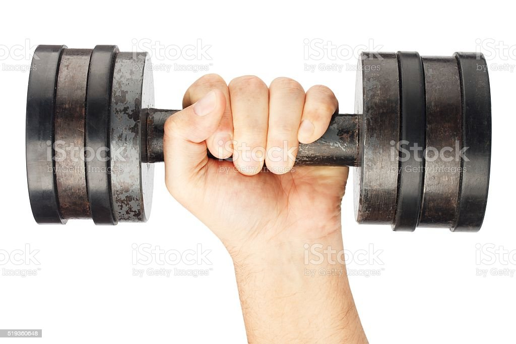 Old dumbbell with removable weights in hand stock photo