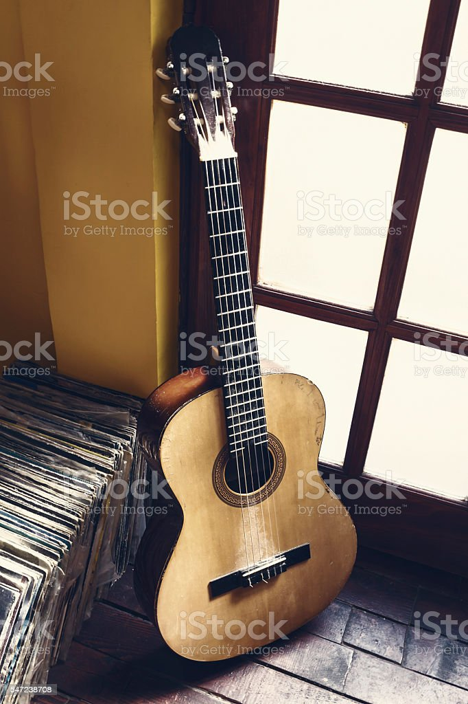 Old dusty guitar stock photo
