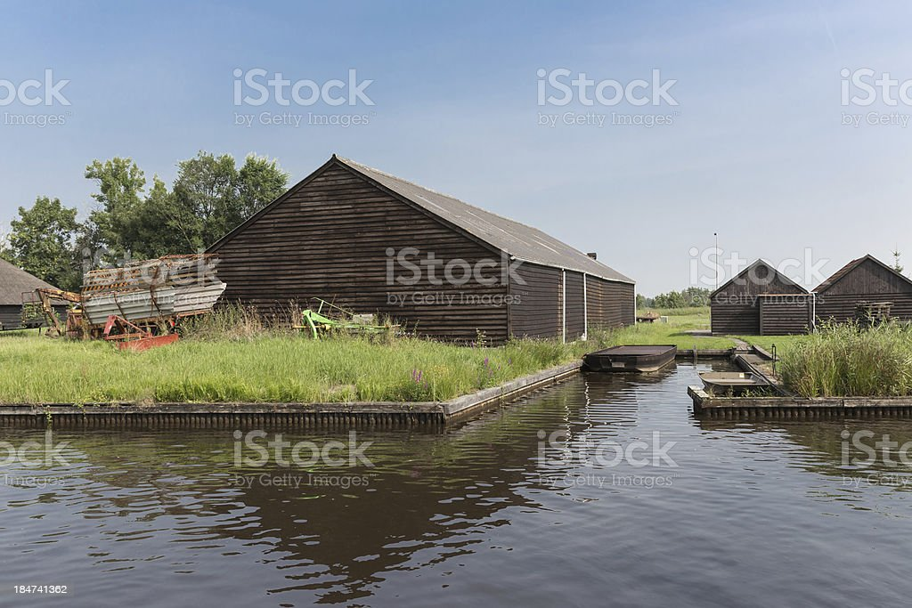 Old Dutch wooden barns near a canal stock photo