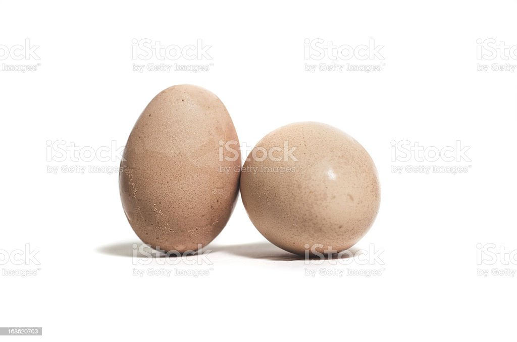 old eggs on isolated background stock photo