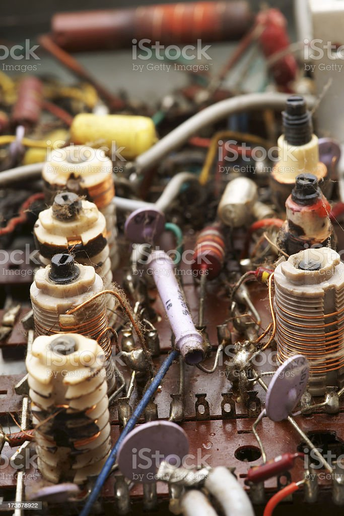 Old elctronic circuits in vacuum tube radio vertical stock photo