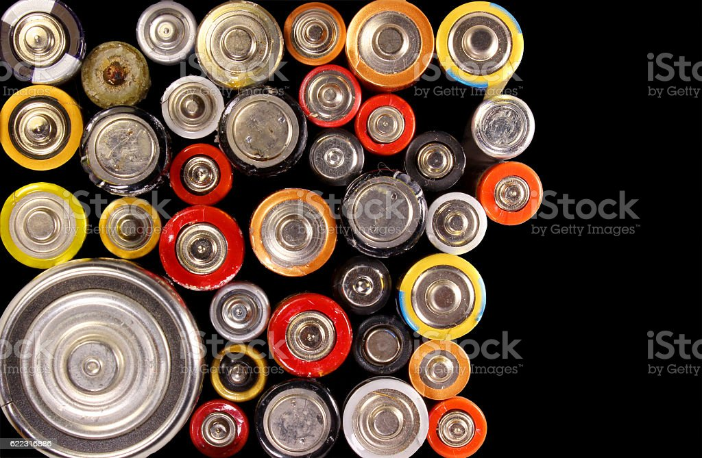 Old electric batteries on black background stock photo