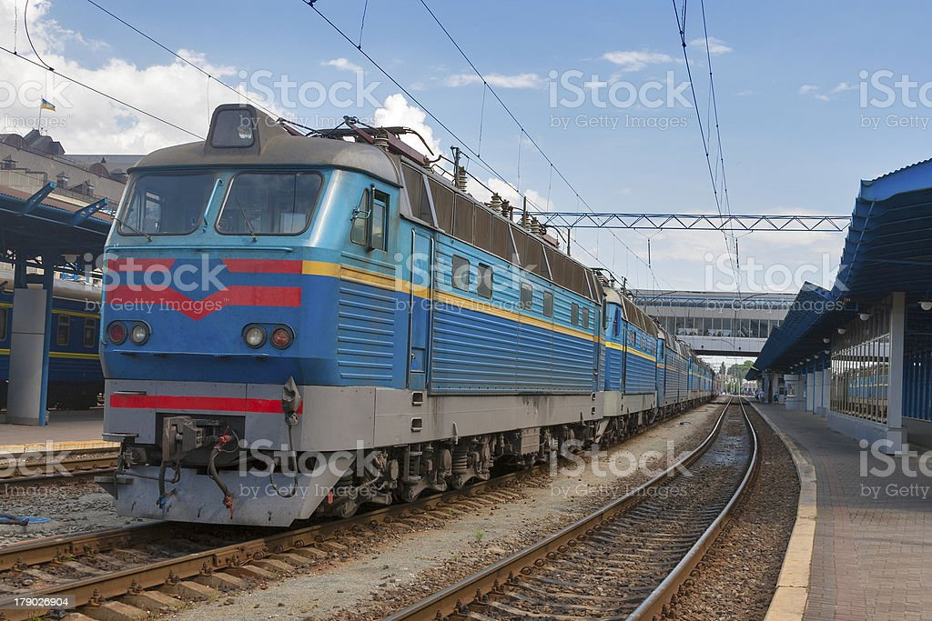 Old electric locomotive at railroad station royalty-free stock photo