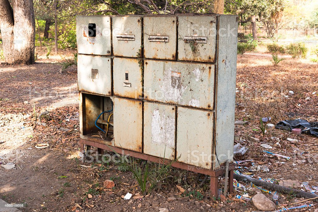 Old electric panel in dirty unsafe condition stock photo