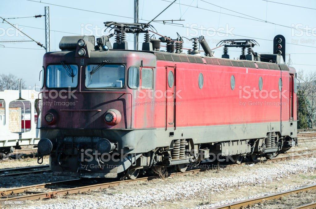 Old electric train locomotive on the rail tracks. stock photo