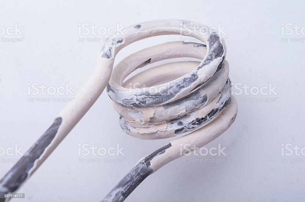Old electric tubular heater-calcification stock photo
