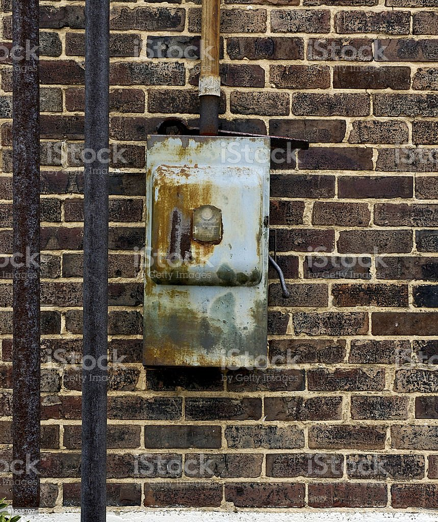 old electrical box on brick wall royalty-free stock photo