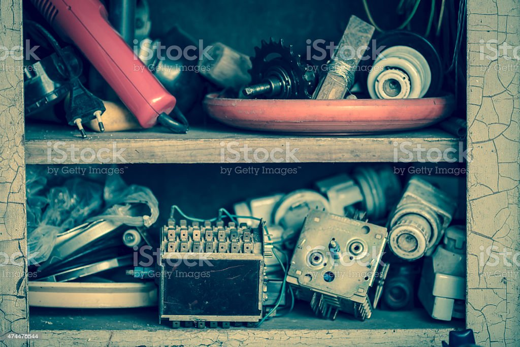 Old electrical junk in shelf stock photo