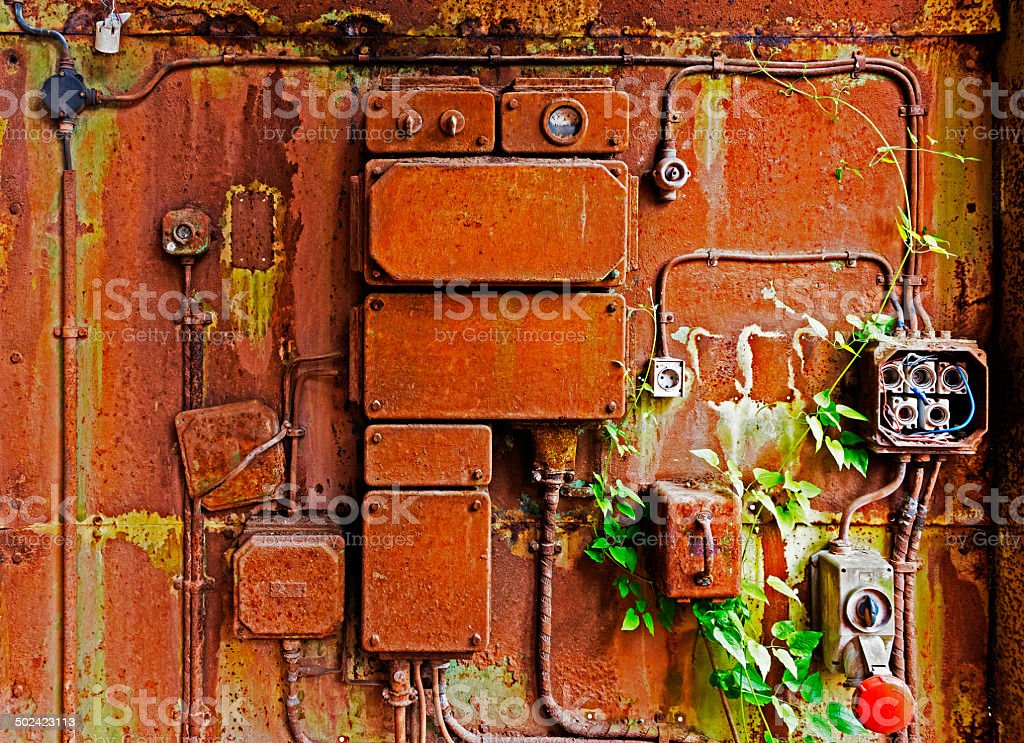 Old electrical panel on iron wall stock photo