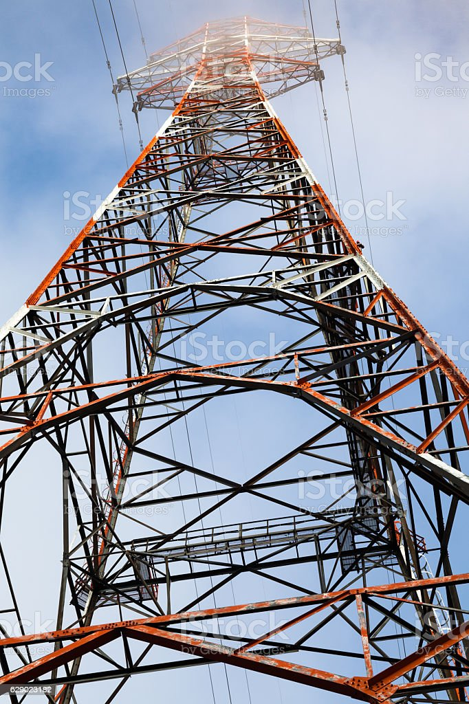 Old electrical tower in the clouds stock photo