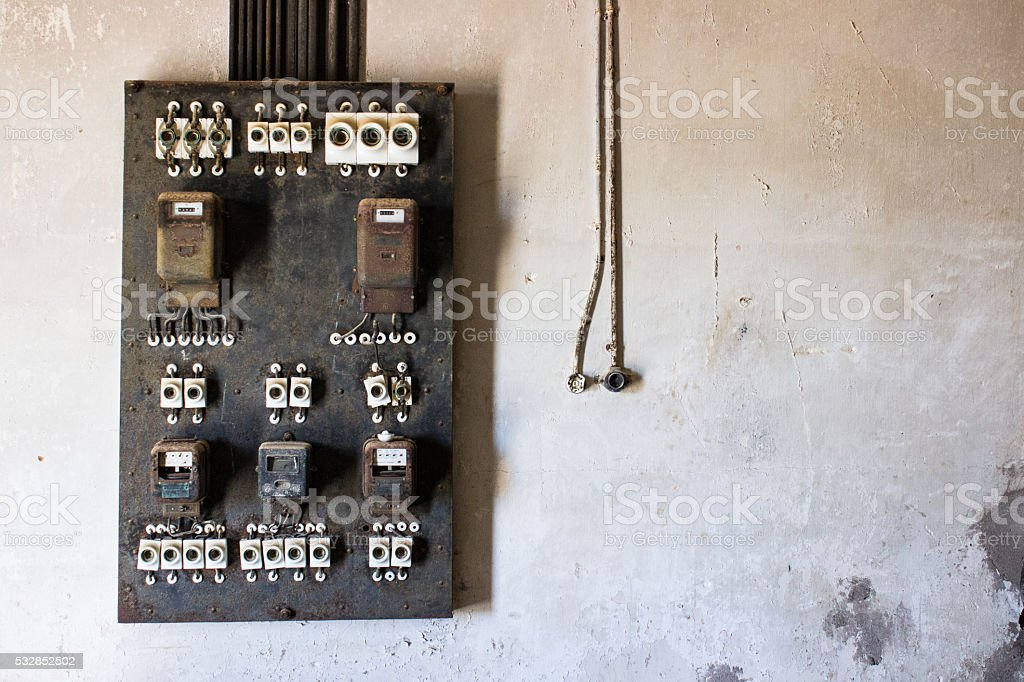 Old electricity control panel at an abandoned house stock photo