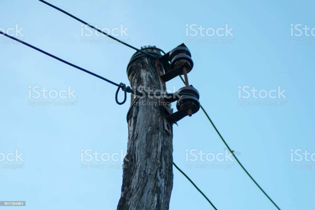 old electricity wooden pole stock photo