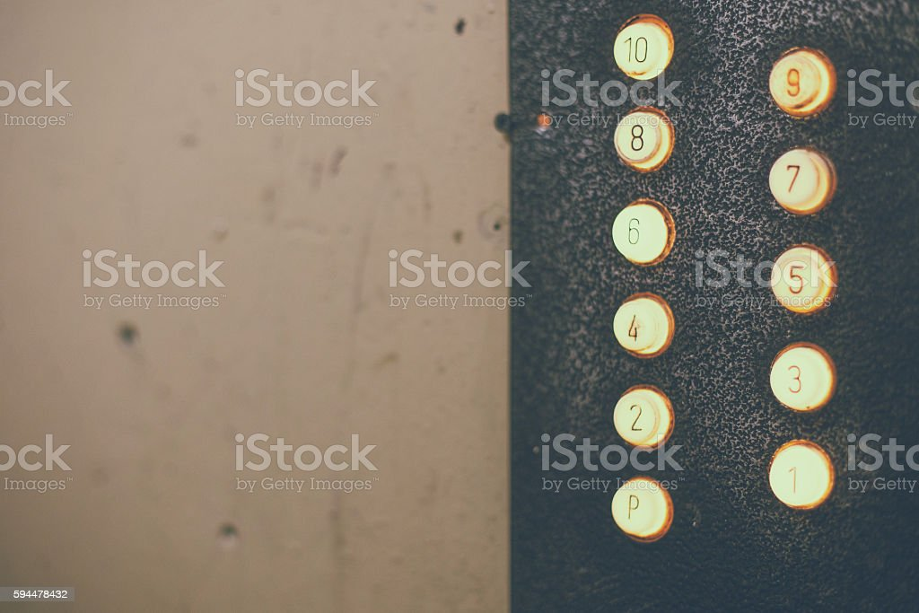 Old elevator, buttons, numbers of floors stock photo